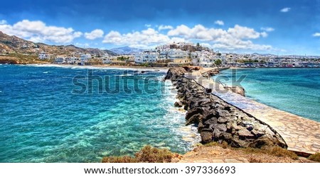 beautiful Cyclades Island Naxos seen from the famous landmark the Portara with the natural stone walkway towards the village  - stock photo