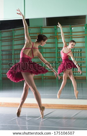 beautiful dancer ballerina is doing exercises in ballet class - stock photo