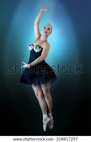 Beautiful dancer in ballet pose, grace in motion - stock photo