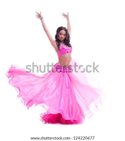 Beautiful dancer in pink costume - oriental dance - stock photo