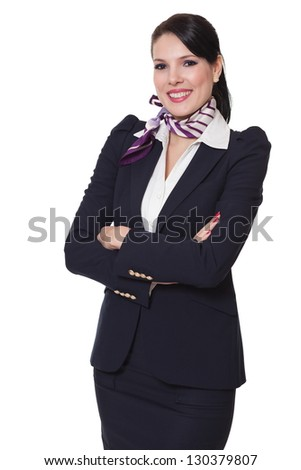 Beautiful dark haired young business woman dressed in a navy suit with a purple scarf and white shirt standing smiling and holding her arms crossed, isolated on white background - stock photo