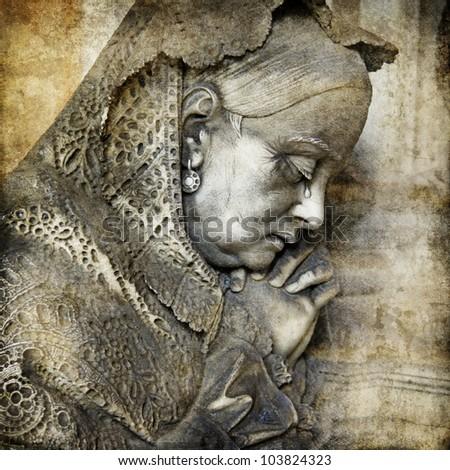 beautiful dark sculptures - Staglieno cemetery, Genoa,Italy. Artistic picture - stock photo