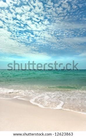 Beautiful day on a pristine beach on the Emerald Coast of Florida - stock photo