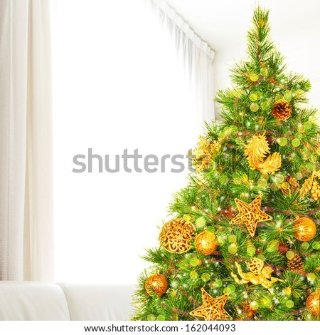 Beautiful decorated Christmas tree at home, luxury golden decoration, happy New Year celebrations, winter holidays concept - stock photo