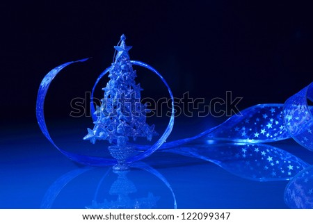 Beautiful Decorated Christmas tree on a darl background - stock photo