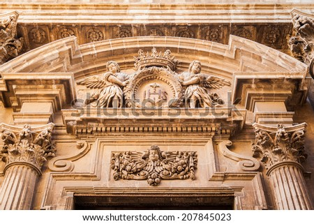 beautiful decoration above entrance to the building in baroque style in Siracusa, Sicily, Italy - stock photo