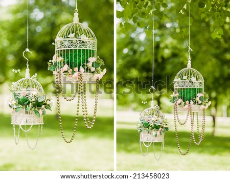 beautiful decorative iron cage hung on a tree in the forest - stock photo