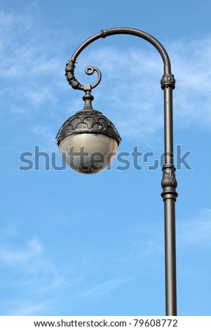 Beautiful decorative lamp post on the background of blue sky - stock photo