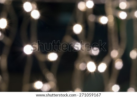 Beautiful defocused LED lights filtered bokeh abstract with warm tone background. - stock photo