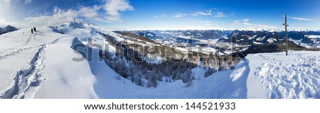 Beautiful 180 degree winter panorama on top of a mountain in the Italian alps on a sunny day - stock photo