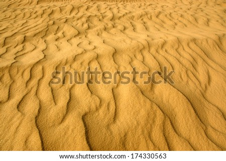 Beautiful desert dunes and sand textures in the sahara desert  - stock photo
