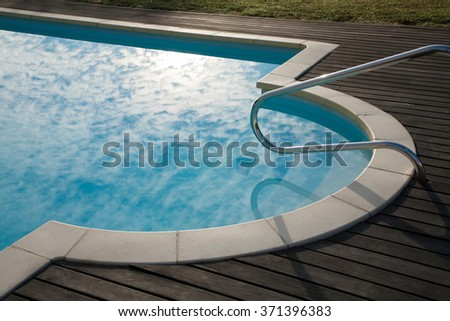 Stair rail stock photos images pictures shutterstock for Swimming pool cloudy blue water