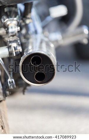 beautiful detail of the motorcycle. exhaust pipe - stock photo