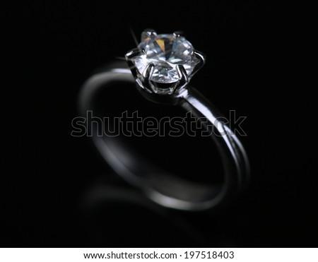 Beautiful diamond ring isolated on black - stock photo