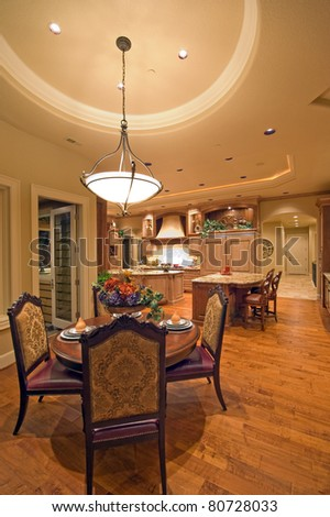 Beautiful Dining Room and Kitchen in Luxury Home - stock photo