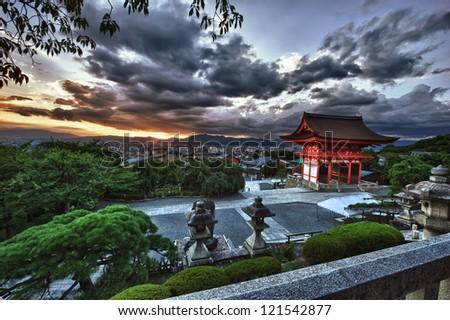 Beautiful dramatic sunset seen from the Kiyomizu-dera shrine above Kyoto, Japan. HDR - stock photo