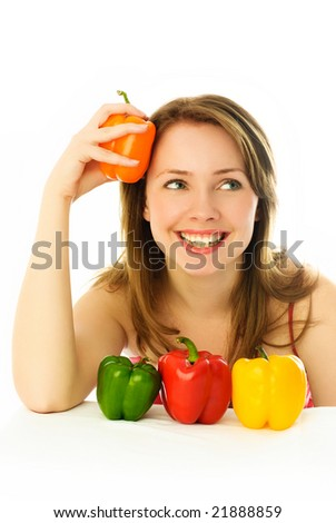 beautiful dreamy young brunette woman with colorful peppers - stock photo