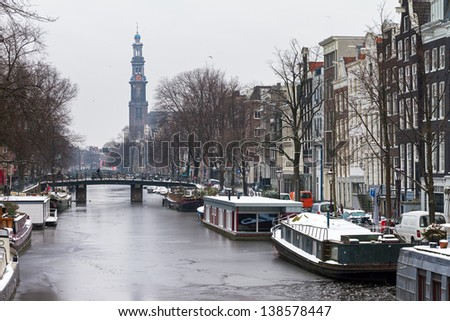 Beautiful early morning winter view on the Westerkerk and the Prinsengracht, one of the Unesco world heritage city canals of Amsterdam, The Netherlands. - stock photo
