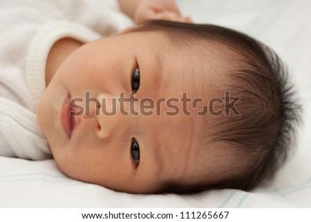 Beautiful East Asian Infant Girl Lying Down - stock photo