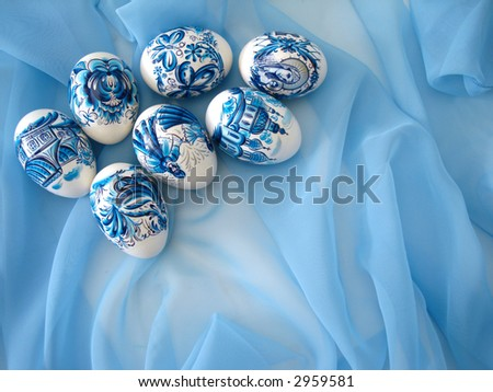 beautiful easter eggs on blue background - stock photo