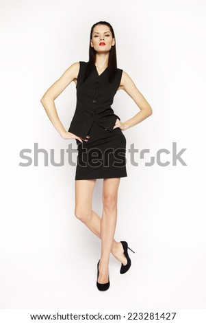 Beautiful elegant brunette woman in black isolated on white background - stock photo