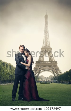 Beautiful elegant couple in front of the Eiffel Tower - stock photo