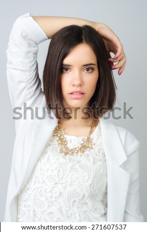 Beautiful elegant girl posing in studio isolated on gray background. - stock photo