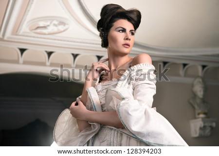 Beautiful, elegant lady in manor house - stock photo