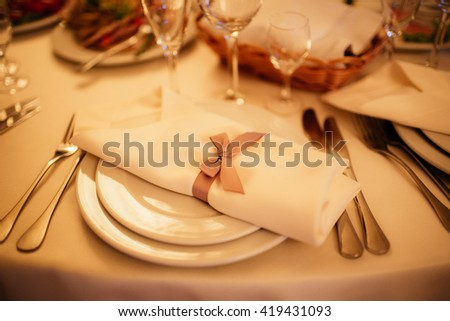 Beautiful elegant served wedding reception table arrangement catering closeup - stock photo