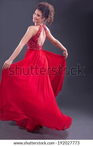 beautiful elegant woman in red dress - stock photo