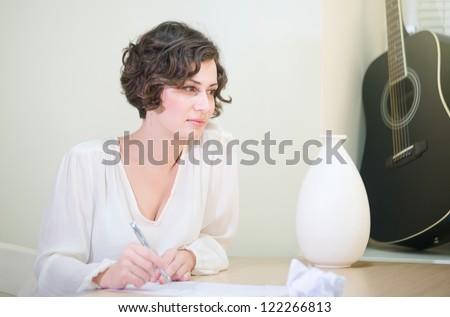 Beautiful elegant woman writing - stock photo
