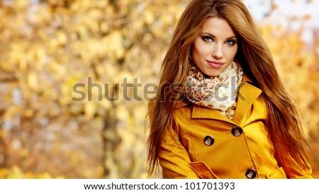 Beautiful elegant womanin autumn park - stock photo