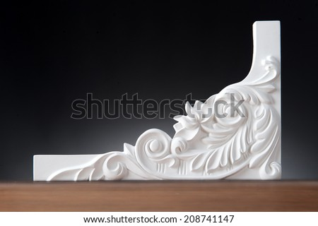 Beautiful elements of luxury wall design, white stucco mouldings over dark background, antique plastering  - stock photo