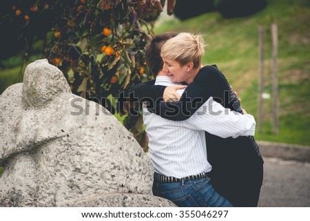 Beautiful embraced couple in the park  - stock photo