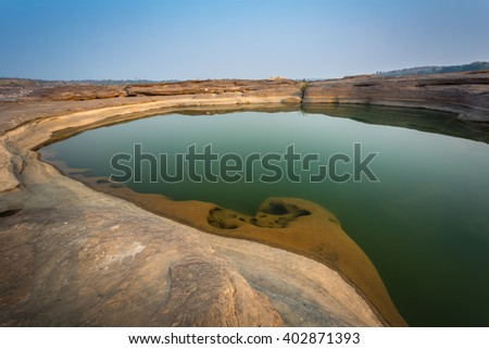 beautiful emeral color pond in a canyon of Sam Pun Bok in Ubonrachatani province northeastern of thailand - stock photo