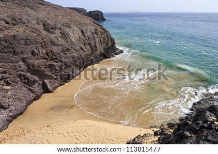Beautiful empty El Papagayo small beach in late afternoon sunshine, Lanzarote, Canary Islands, SPain - stock photo