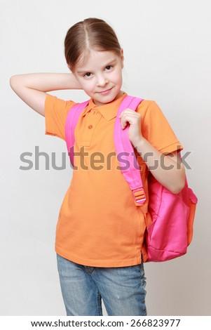 Beautiful european little girl holding school bag - stock photo