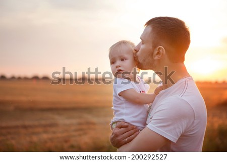 Beautiful evening sunset, happy father and son, summer, sunny photo - stock photo
