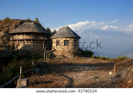 Beautiful evening view of the classic house near Himalayan mountains when see from Sarangkot, Pokhara, Nepal - stock photo