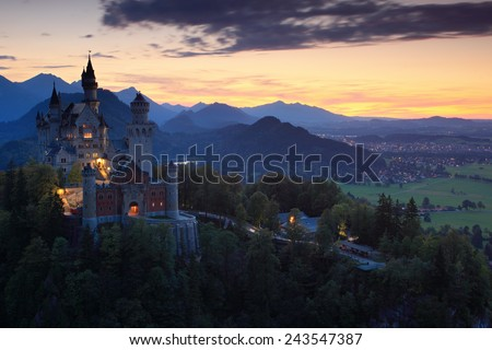 Beautiful evening view of the Neuschwanstein castle, with autumn colours during sunset, Bavarian Alps, Bavaria, Germany - stock photo