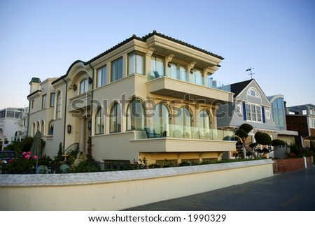 beautiful executive luxury home with arched windows and medeteranean style - stock photo