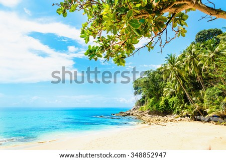 Beautiful exotic beach with white sand and lush vegetation on the background of azure water, Thailand, South Asia - stock photo