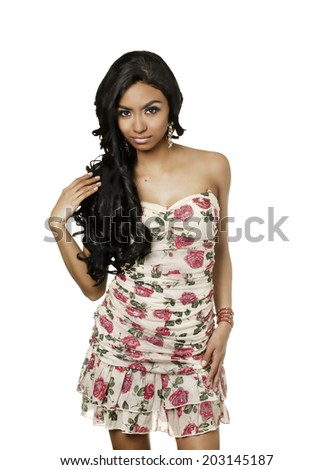 Beautiful exotic mixed race young woman wearing flower summer dress isolated against white background - stock photo