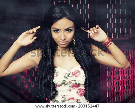 Beautiful exotic young woman in dress - stock photo