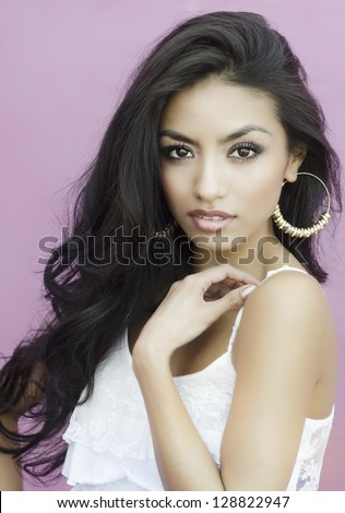 Beautiful exotic young woman with gorgeous face and long silky dark hair. - stock photo