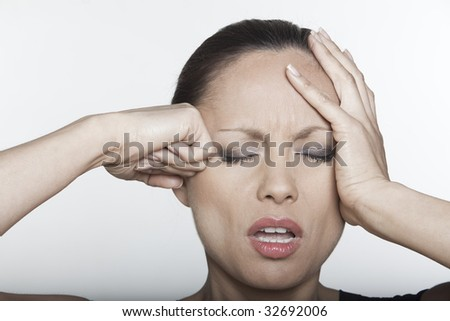 beautiful expressing woman portrait on isolated background confused headache hangover - stock photo