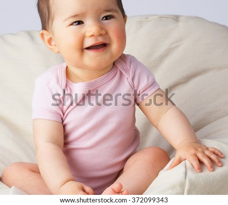 Beautiful expressive adorable baby - stock photo