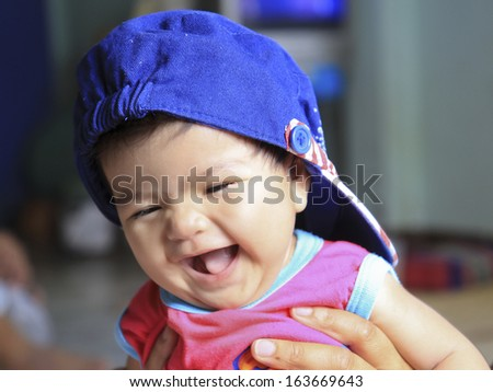 Beautiful expressive adorable happy cute laughing smiling baby. - stock photo