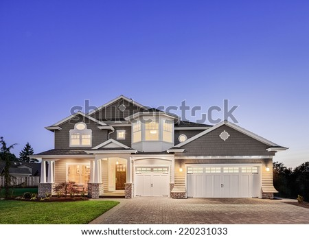 Beautiful Exterior of New Home at Twilight - stock photo