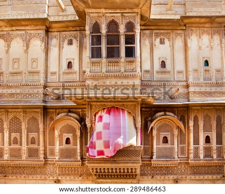 Beautiful exterior of the old carved sandstone mansion with beautiful balconies, Jodhpur, India - stock photo
